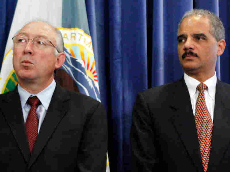 Attorney General Eric Holder (right) and Interior Department Secretary Ken Salazar