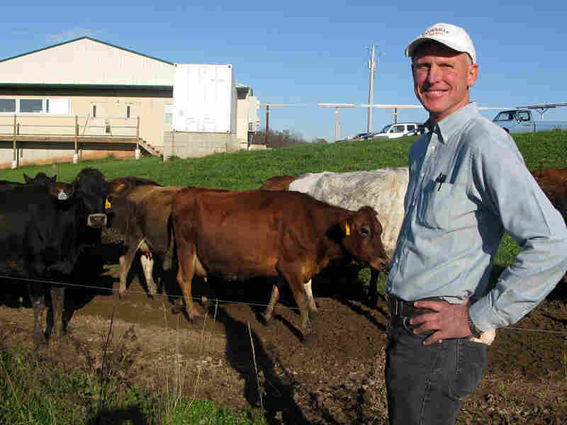 Warren Taylor with cows on the farm that provides milk to Snowville Creamery, in Pomeroy, Ohio.