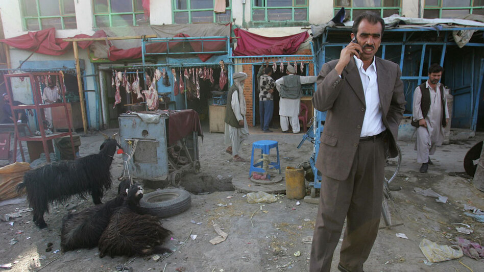 A man talks on his cell phone in Kabul, Afghanistan, in this 2007 photo. As part of its initiative to use technology to address global problems, the State Department is working on better ways to protect mobile phone service in Afghanistan from insurgent attacks.