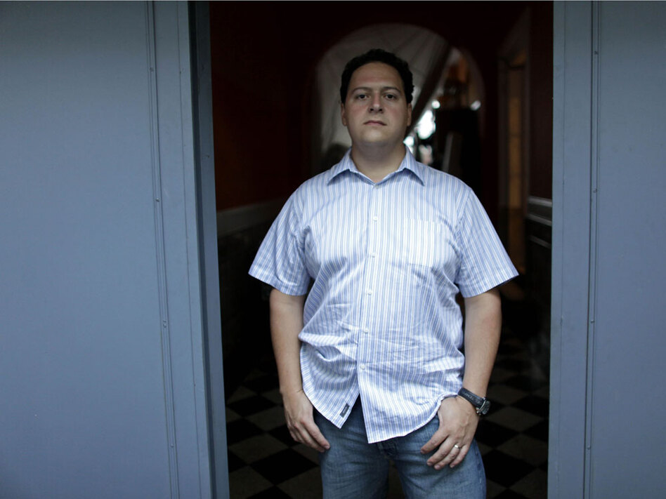 Sebastian Marroquin, son of Colombia's late drug lord Pablo Escobar, poses for a photo in Buenos Aires, Argentina, where he has lived since fleeing Colombia in 1994. Until recently, he led a low-profile existence. Now, he is giving up anonymity and asking forgiveness for his father's reign of terror in a new documentary, Sins of My Father. (AP)
