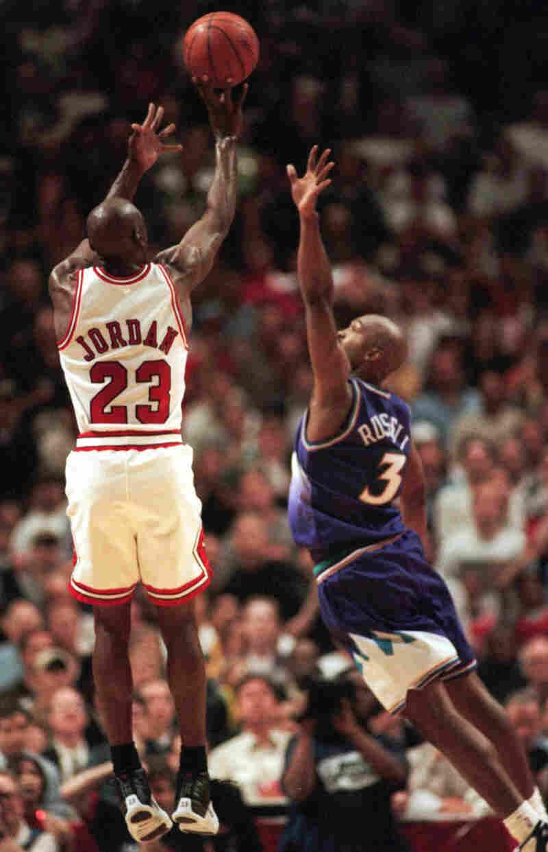 Michael Jordan puts up the game-winning shot over Bryon Russell.