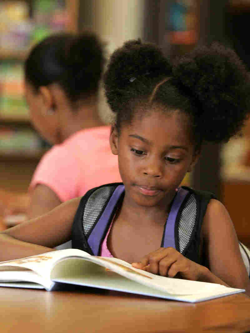v-My'angel Dooley, 7, reads a book as part of an after-school program in Columbus, Ohio