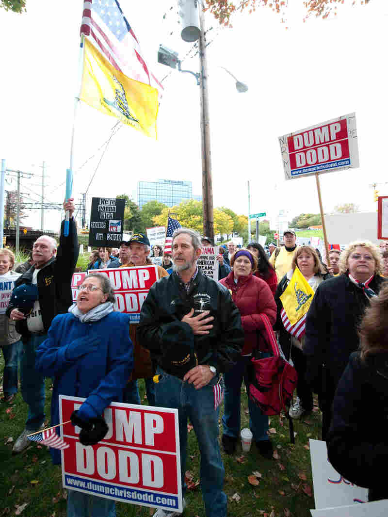 Protesters at a fundraiser greeted Dodd with a 'Dump Dodd' sign.