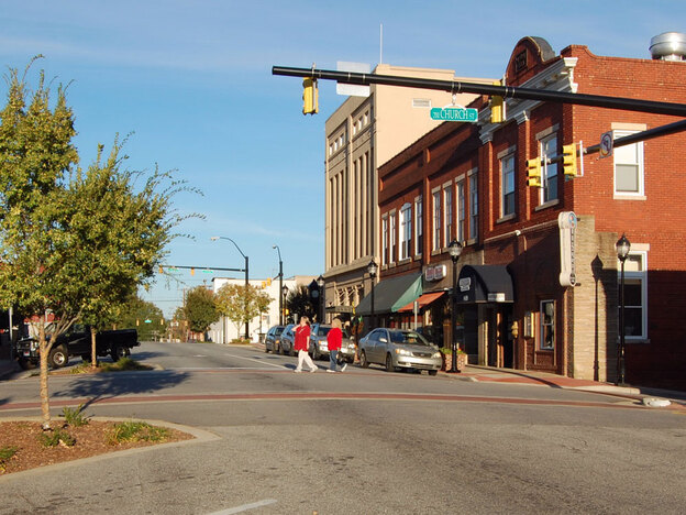 Lenoir is a city of 18,000 in the foothills of the Blue Ridge Mountains. Hard-hit by outsourcing of furniture jobs and the recession, the city's downtown sees little traffic.