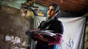 Laila Al Nabulsi, 12, stands in what she now calls home