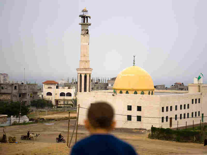 Damage remains visible on the minaret of a mosque in Gaza City marred in last year's Israeli offensi