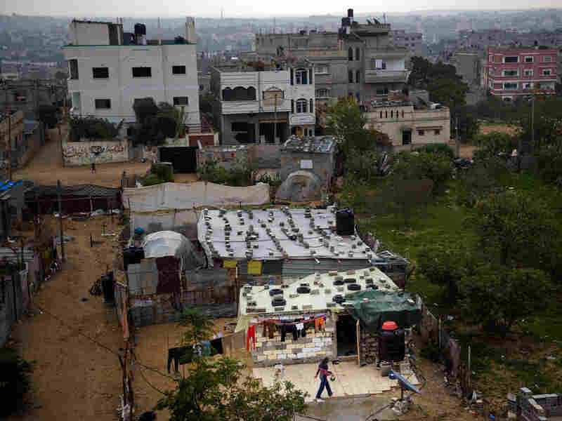 In Gaza City's Tawam neighborhood, families have built makeshift homes out of bricks, old tires and