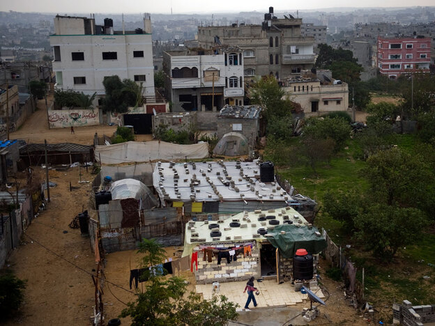In Gaza City's Tawam neighborhood, families have built makeshift homes out of bricks, old tires and metal sheeting. What was once a middle-class area now looks like a shantytown.