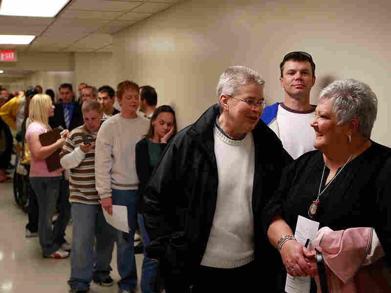 Gay couples wait in line to request a marriage license  in Des Moines, Iowa.