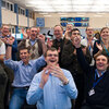 Physicists at CERN labs celebrate the repair of the large hadron collider.