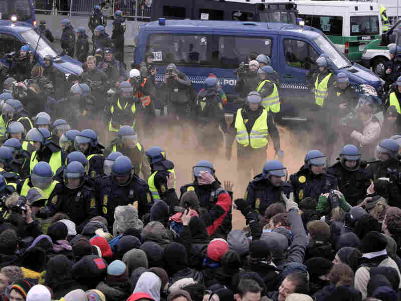 Danish riot police push back protesters outside the U.N. Climate Conference in Copenhagen.