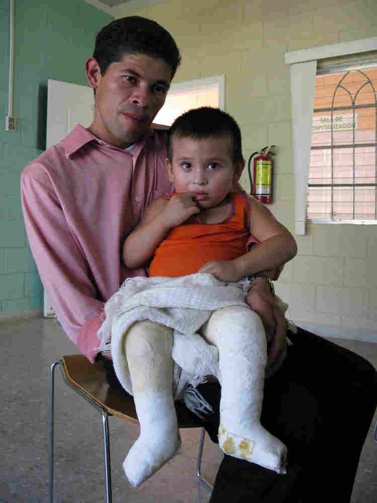 Roberto Silva, 31, holds his 3-year-old son, Adil Noe Silva, at the CURE Pediatric Hospital