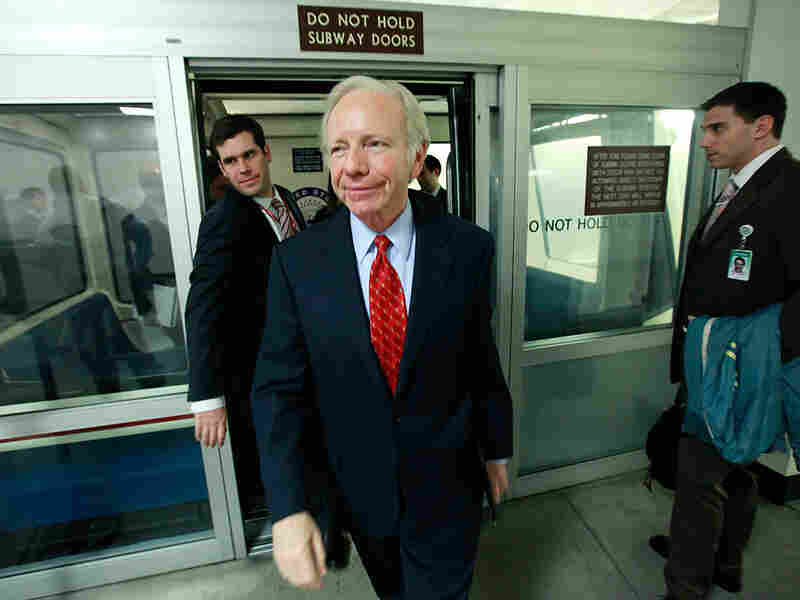 Sen. Joseph Lieberman walks off the Capitol subway after speaking to reporters about health care.