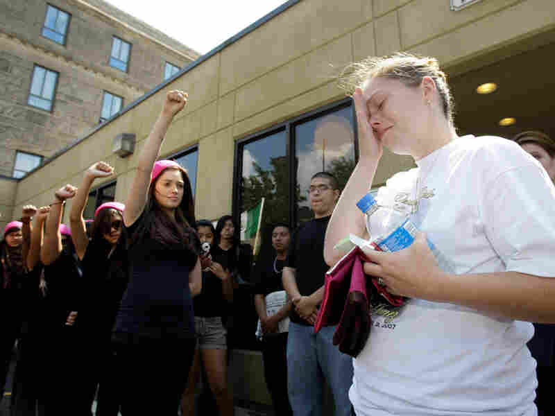 Crystal Dillman, the fiancee of Luis Ramirez, is moved to tears outside the courthouse.