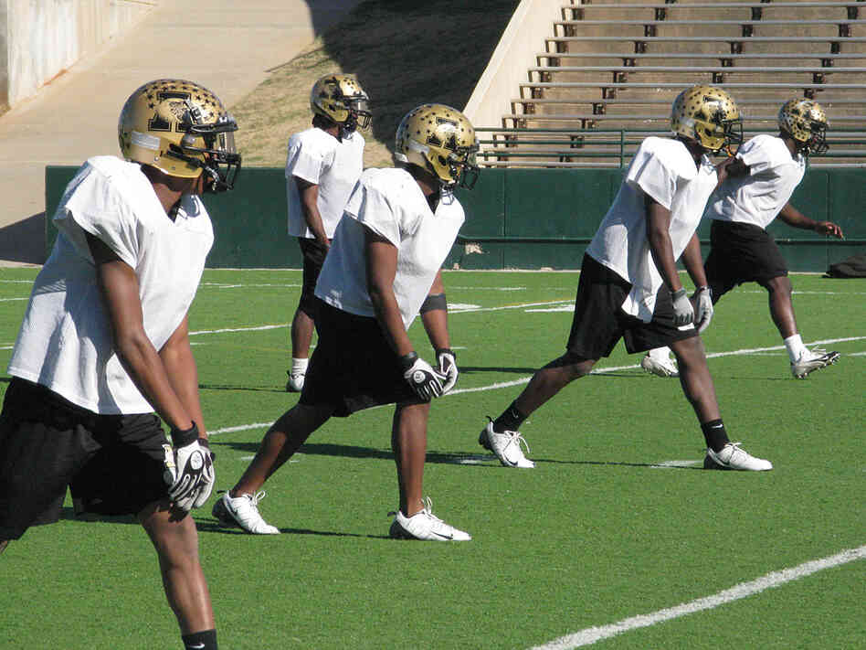 Abilene high school football players practice for the state championship game.