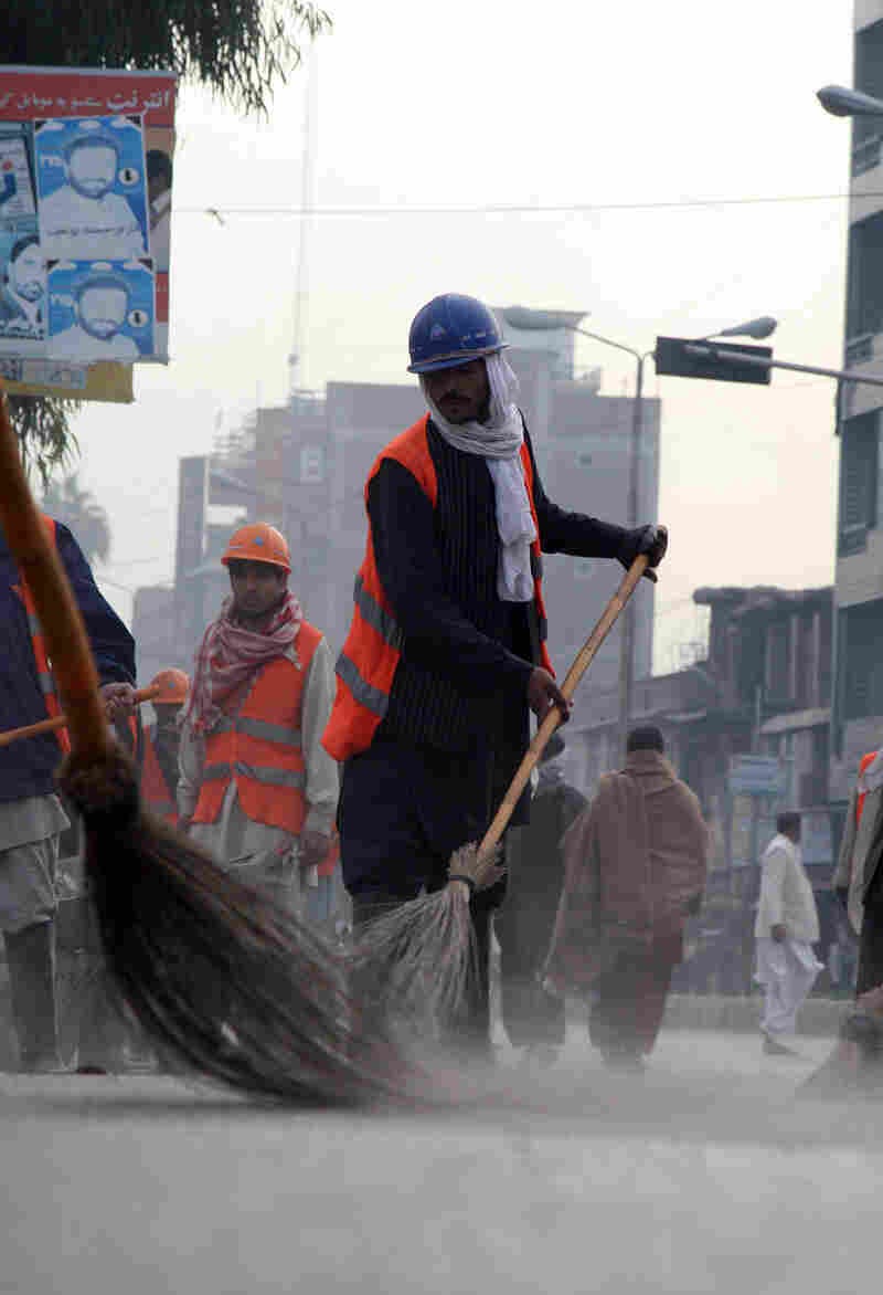 Street sweepers in the Afghan city of Jalalabad