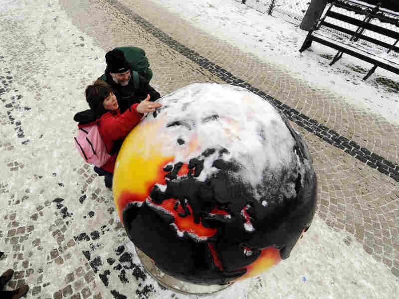 "A snow-covered ""Cool Globe"" in Copenhagen"