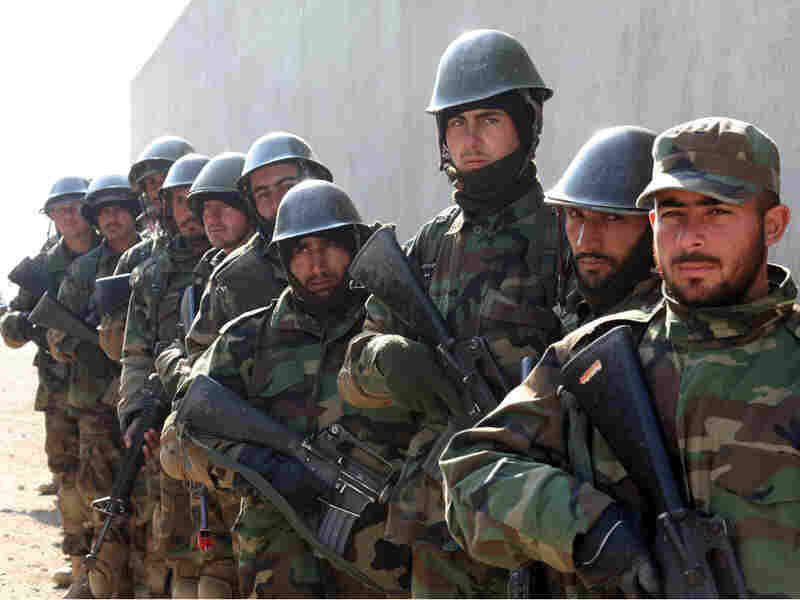Afghan soldiers prepare to run a mock raid on a house.