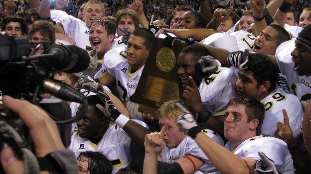 (Wide Image) The 2009 Abilene High School Eagles hold their championship trophy.