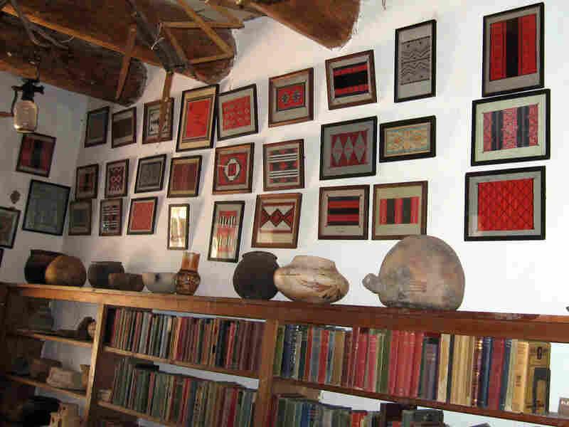 'Rug room' wall with framed paintings of Navajo rug designs