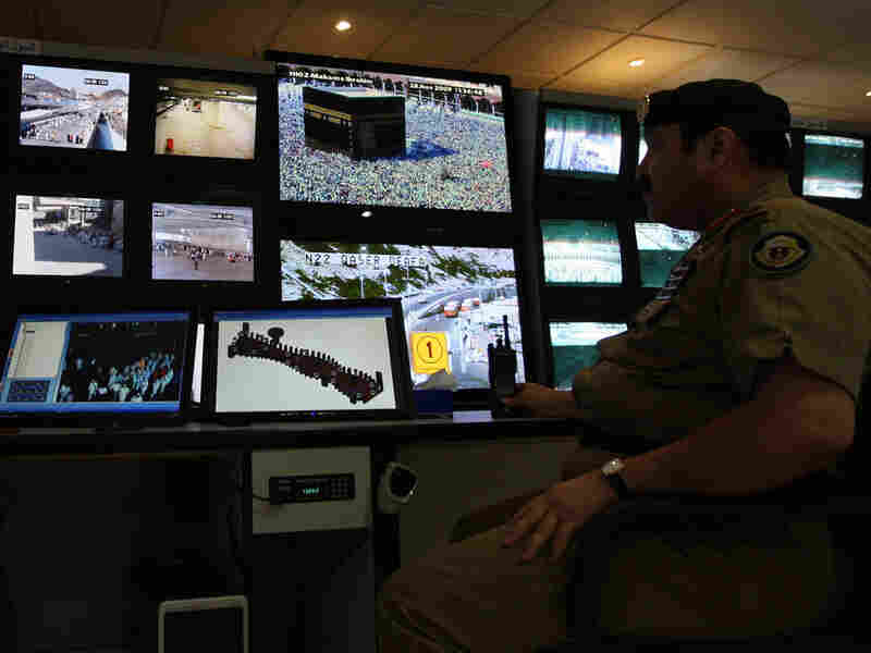 Saudi police officers monitor screens connected to cameras set up at holy places near Mecca.