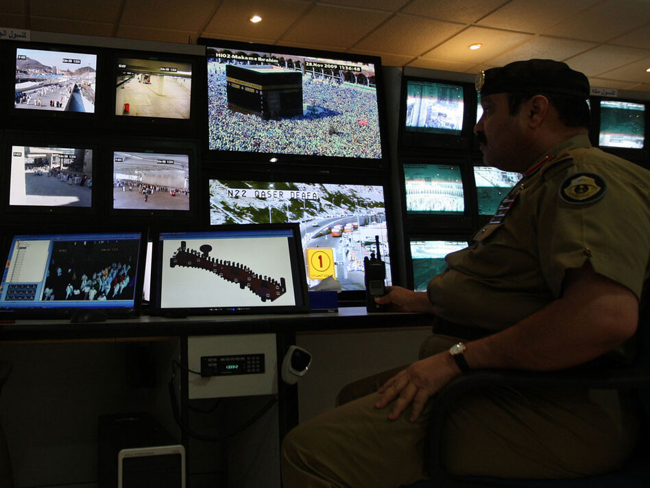 Saudi police officers monitor screens connected to cameras at all of the holy places in Mina near Mecca, Saudi Arabia, in November.