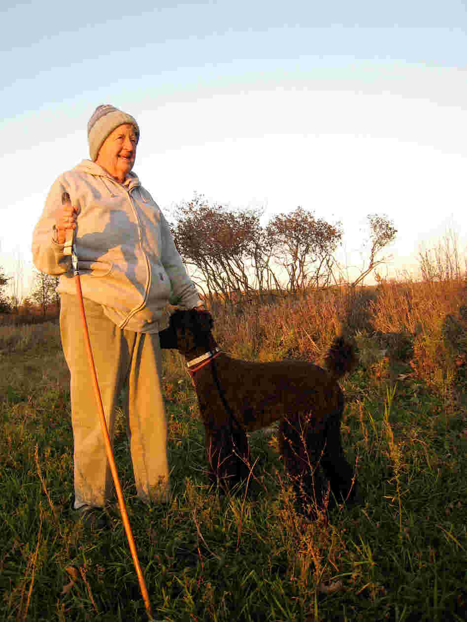 Joan Graham standing at her proposed burial site on her land.