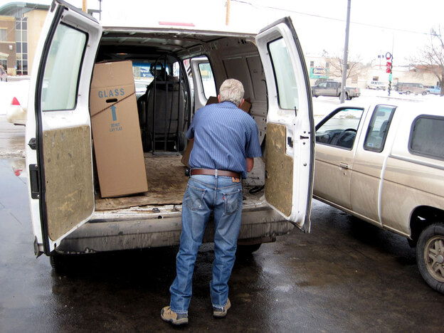 Rapid Delivery driver Dennis Radlinger loads packages into his truck.