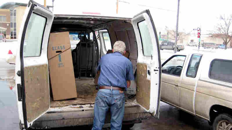 Wide: Rapid Delivery driver Dennis Radlinger loads packages into his truck.