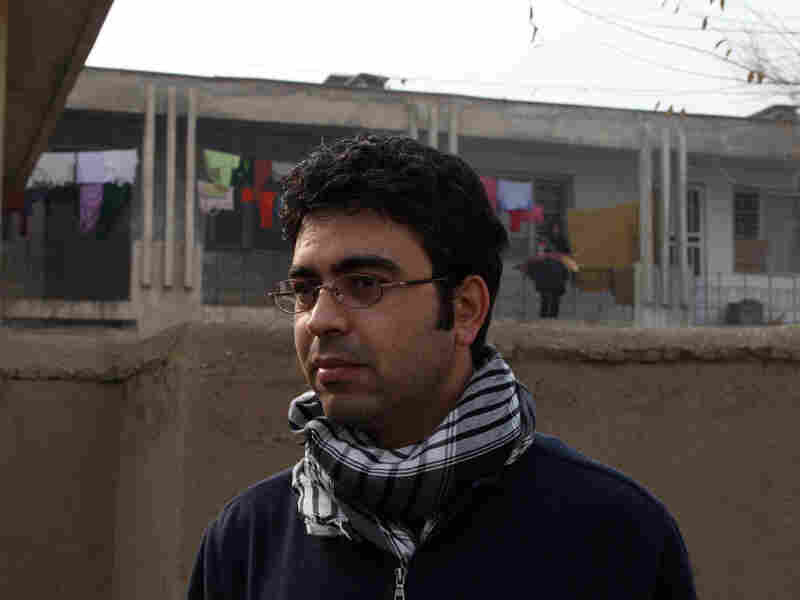 Akmal Sawi stands in front of his childhood apartment.
