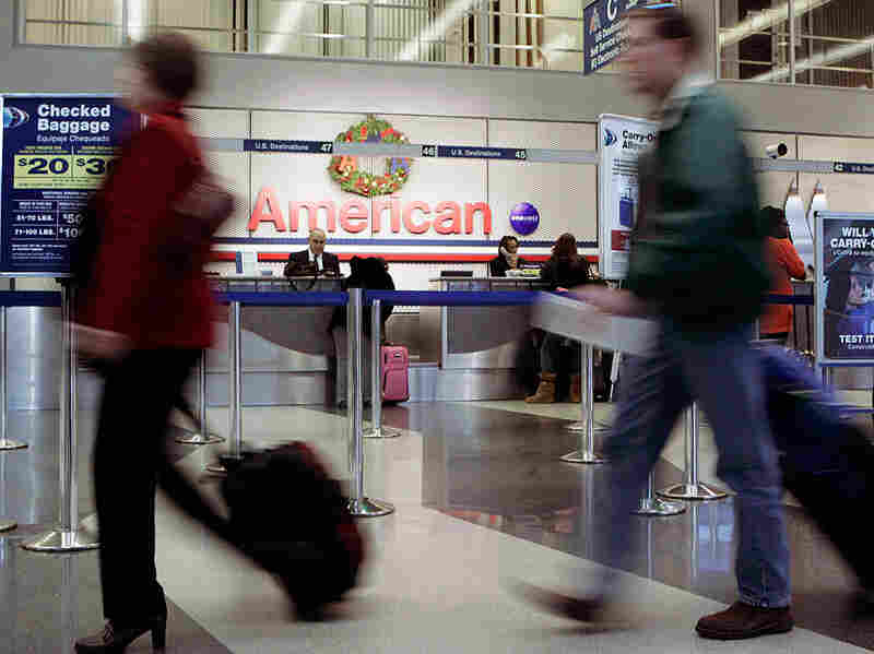 Passengers walk to the TSA check-in inside the American Airlines terminal at O'Hare.