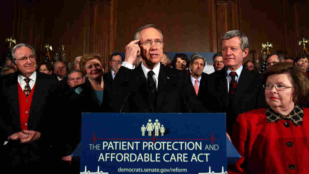 wide: Senate Majority Leader Harry Reid (D-NV) speaks at a rally of Democratic senators.