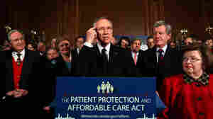 wide: Senate Majority Leader Harry Reid (D-NV) speaks at a rally of Democratic senators.