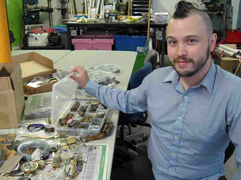 Schuyler Towne, a locksporter, with his lock library.