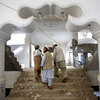 Contractors walk through an apartment complex in Afghanistan.