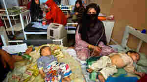 At Mirwais Hospital in Kandahar, toddlers sleep two or three to a bed.