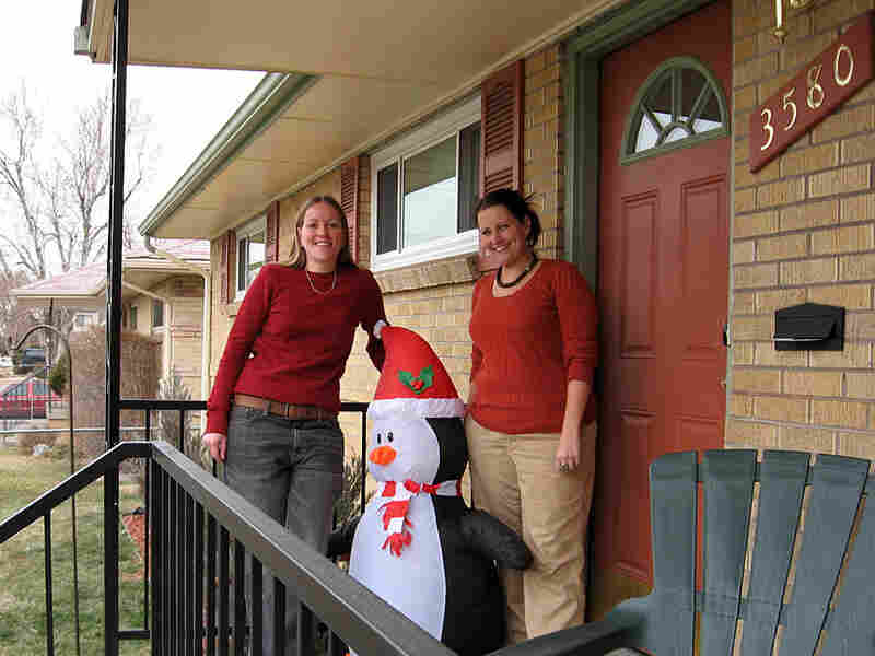 Courtney Gross and Rebecca Wolfstanding on the front porch of their North Park Hill house in Denver.