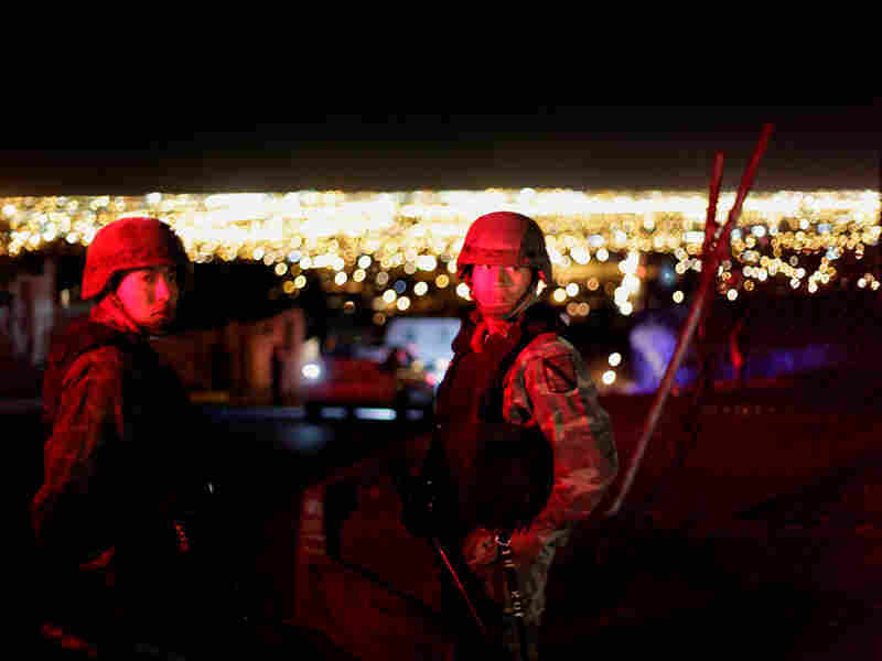 Soldiers patrol on the outskirts of Ciudad Juarez, Mexico.