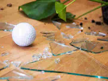 Golf ball and broken glass