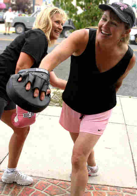 Sara Labbe, left, and Joyce Garrels working out.