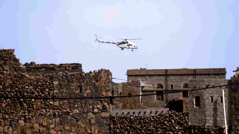 A Yemeni army helicopter flies over  the district of Arhab.