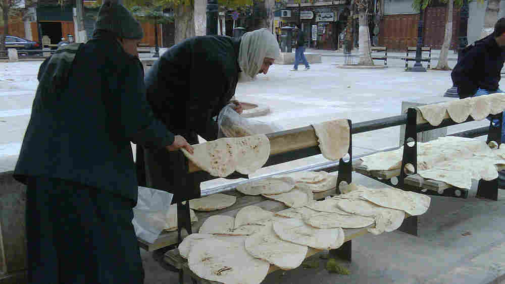 Fresh, hot bread is spread out on any available surface while it cools, a morning ritual in Aleppo.