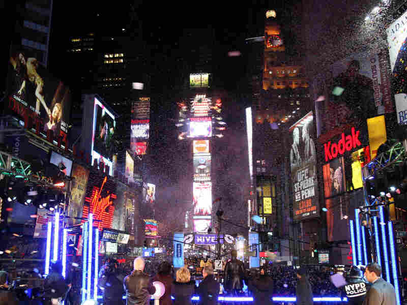 Crowds cheer as midnight arrives and the ball drops in New York's Times Square on Dec. 31, 2008.