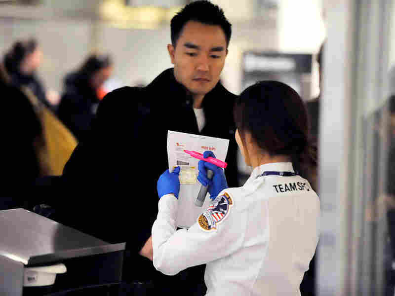 Travelers go through airport security at San Francisco Airport