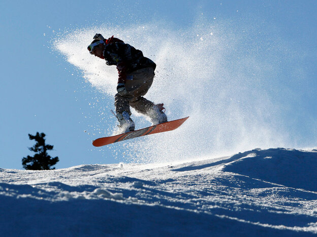 A snowboarder catches air at a resort in Maine. A recent Dartmouth report reveals that resorts report an average of 23 percent more snow on weekends than during the week.