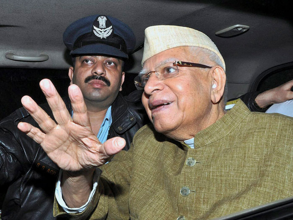 Former Andhra Pradesh state Gov. Narayan Dutt Tiwari (right) looks on from his car after reaching Dehradun, India, on Dec. 28. The 86-year-old Tiwari resigned, citing health concerns, after being allegedly caught on tape in a sex scandal.