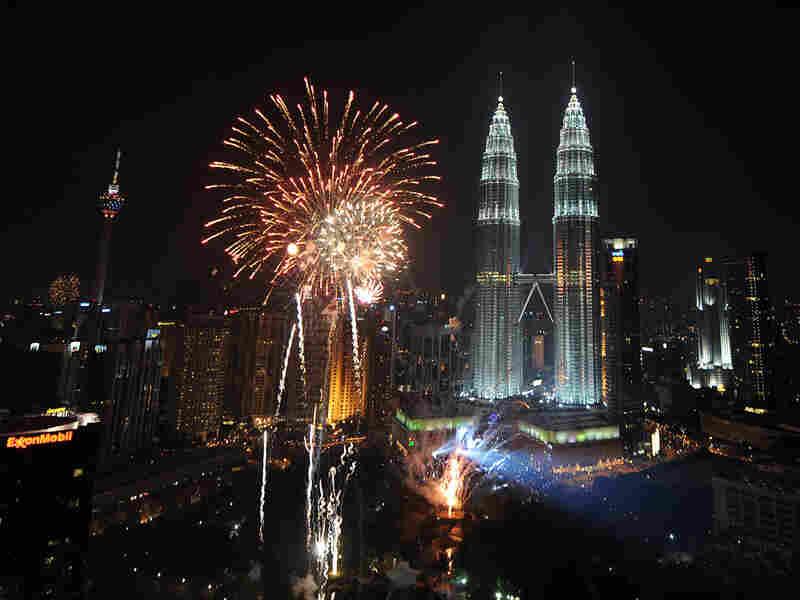 Fireworks explode near Malaysia's landmark Patronas Twin Towers.