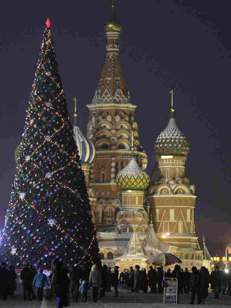 People walk in Moscow's Red Square decorated for New Year's