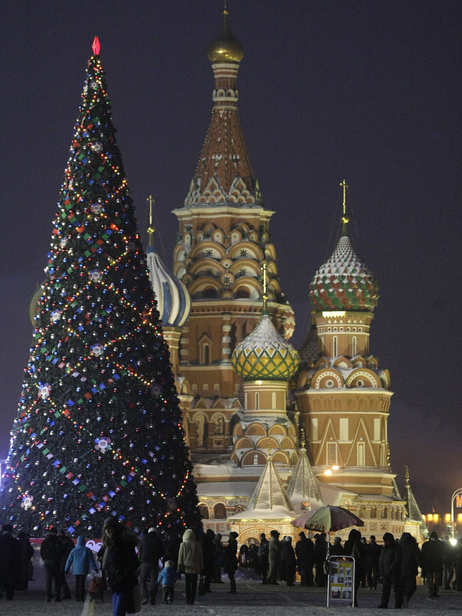 People walk in Moscow's Red Square, which is decorated for one of the biggest holidays of the year: New Year's. Russian retailers expect to bring in about 15 percent of their annual take over the New Year's period.