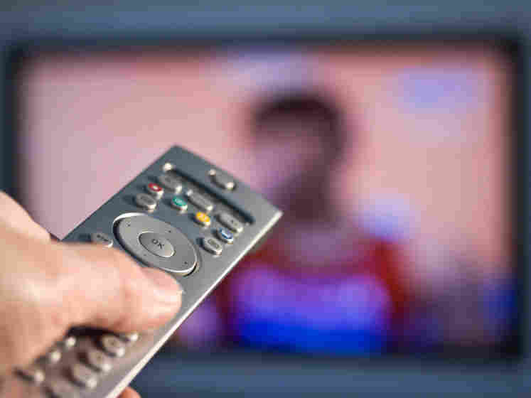 Remote control pointed at a TV. iStockphoto.com